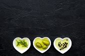 Olive Oil As Healthy Diet Product. Heart Shaped Bowls With Olive Oil With Green Olives, Rosemary And poster
