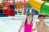 image of inflatable slide  - 	Children playing in pool - JPG