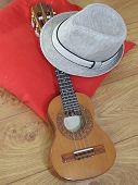 A Samba Player (sambista) Hat And A Cavaquinho, A Brazilian String Musical Instrument, On A Red Pill poster