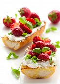 Strawberry bruschetta with goat cheese,basil and balsamic vinegar