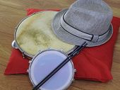 Close-up Of A Samba Player (sambista) Hat And Two Brazilian Percussion Musical Instruments: tambori poster