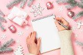 Christmas Goals, Plans, Resolution, Wish List. Woman Hands Write Christmas Goals Or Wish List. Top V poster