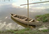 Old Wooden Boat On The River Or Lake Bank. Boat And Reflection Of Sky. Rowboat. Fishing Boat. poster