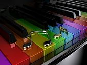 foto of rainbow piano  - The black piano with keys of different colours of a rainbow - JPG