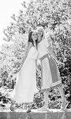Friendship Concept. Girls Friends Summer Dress Outfit Nature Background. Friendly Relations. Summer  poster