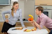 stock photo of indecent  - Happy Couple having fun on a kitchen - JPG