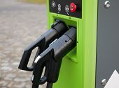Charging Station For Electric Vehicles. Eco Charging Station In Green. Large View poster