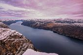 Panoramic View Of The Lysefjord From The Famous Preikestolen Pulpit Rock, Some Snow On The Peaks And poster