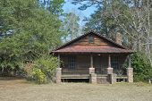 stock photo of backwoods  - An old cabin in the southern countryside of South Carolina - JPG