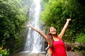 image of hawaiian girl  - Hawaii woman tourist excited by waterfall during travel on the famous road to Hana on Maui - JPG