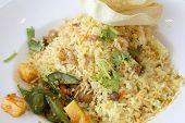 foto of nasi  - Indian Nasi Briyani Rice Dish with Pickled Vegetable and Crackers Local Dish Closeup - JPG