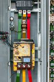 foto of fuse-box  - Industrial fuse box on the wall closeup photo - JPG