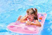 pic of inflatable slide  - Child on water slide at aquapark - JPG