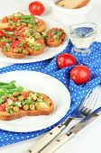 picture of hardtack  - Sandwiches with vegetables and greens on plate on wooden table close - JPG