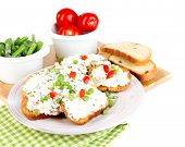 foto of hardtack  - Sandwiches with cottage cheese and greens on plate isolated on white - JPG