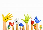 stock photo of child development  - Image of human hands in colorful paint with smiles - JPG