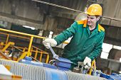 pic of assemblage  - industrial worker with spanner at factory construction workshop - JPG