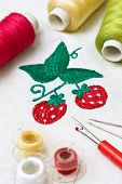 stock photo of thread-making  - machine embroidery image strawberry tools for embroidery - JPG