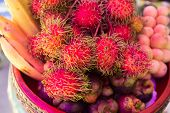 foto of lanzones  - rambutanbanana mangosteen and Lanzones in a bowl - JPG