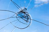 stock photo of thug  - Closeup of smashed glass panel cracked and broken - JPG