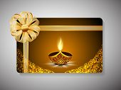picture of diwali lamp  - Diwali festival gift card with illuminated lit lamp and ribbon decoration on stylish brown background - JPG