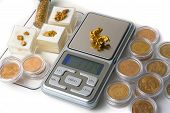 stock photo of gold nugget  - Weighed on a precision balance to the thousandth of a gram of alluvial gold in the form of flakes and natural nuggets - JPG