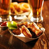 stock photo of serving tray  - barbecue buffalo chicken wings served with beer - JPG