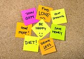 stock photo of quit  - Group of New year Resolutions Post it Notes on pink yellow orange and green on cork board written with message of diet join gym find love quit smoking and be happy - JPG