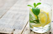 stock photo of mint-green  - lemonade with mint on a dark wood background - JPG