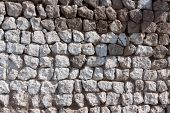 image of mortar-joint  - Stone wall made of volcanic stone as background - JPG