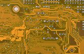 picture of byte  - Close up of a printed orange computer circuit board - JPG