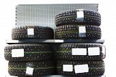 image of stud  - New modern studded winter tires on the shelf in the store - JPG