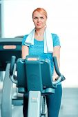 stock photo of exercise bike  - Cycling on exercise bike - JPG