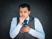 pic of pneumonia  - Closeup portrait sick mature worker executive guy in blue tie and vest having severe infectious cough holding chest raising fist to mouth looking miserable - JPG