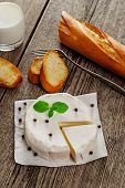 foto of baguette  - French traditional camembert cheese with baguette on wood table