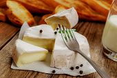 image of baguette  - French traditional camembert cheese with baguette on wood table - JPG