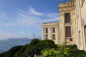 picture of alcatraz  - Alcatraz island with the bay in the background on a sunny day - JPG