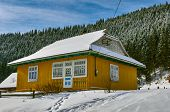 stock photo of chalet  - winter Mountain chalet in the Carpathians Ukraine - JPG