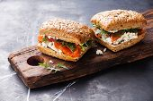 image of sandwich  - Sandwich with cereals bread and salmon on dark marble background - JPG