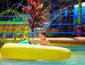 pic of life-boat  - happy kid driving toy water boat in aqua park - JPG