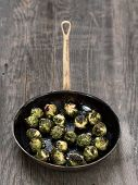 stock photo of brussels sprouts  - close up of a pan of rustic roasted brussels sprout - JPG
