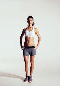image of slim model  - Young woman with beautiful slim healthy body posing in studio - JPG