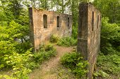 stock photo of crusher  - The remains of a quarry rock crusher in the woods - JPG