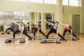 pic of step aerobics  - Group of women making step aerobics in the fitness class