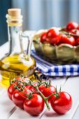 Постер, плакат: Tomatoes Cherry tomatoes Cocktail tomatoes Fresh grape tomatoes carafe with olive oil