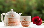 stock photo of teapot  - fresh healthy hot tea in a teapot and cup whit rose - JPG