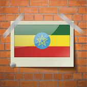 stock photo of ethiopia  - Flags of Ethiopia scotch taped to a red brick wall - JPG