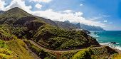 pic of atlantic ocean  - Winding road near coast or shore of Atlantic ocean with mountains and blue sky with clouds and skyline or horizon panorama landscape in Tenerife Canary island Spain at spring or summer - JPG