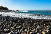 foto of atlantic ocean  - Wild stone beach on shore of the Atlantic ocean with waves and sky with clouds and skyline or horizon in Tenerife Canary island Spain at spring or summer - JPG