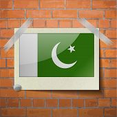 pic of pakistani flag  - Flags of Pakistan scotch taped to a red brick wall - JPG